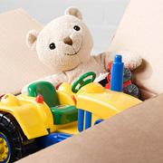 A cardboard box full of toys
